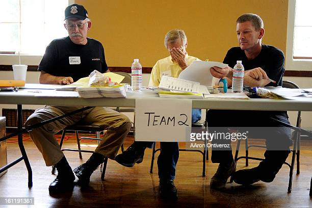 Volunteers John Baker Mike Cowan and Ron Briggs count ballots during a hand review of voted ballots for the clerk and commissioner races of Saguache...