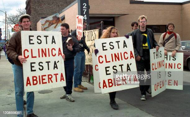 Volunteers keep the entrance to an abortion clinic free from protesters in Chicago Illinois United States on April 27 1992