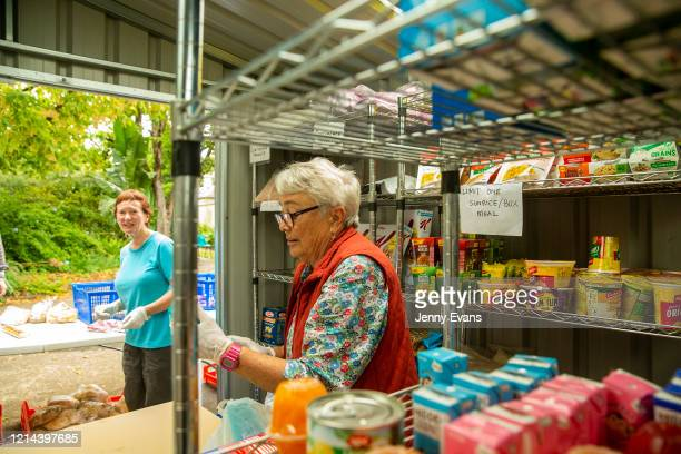 Volunteers Kerin Brown and Felicity Baker are seen with food items at St Paul's Anglican Church in Burwood on March 24 2020 in Sydney Australia The...