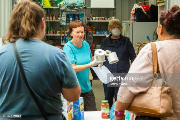 Volunteers Kerin Brown and Margaret Baseley hand out toilet paper at St Paul's Anglican Church in Burwood on March 24 2020 in Sydney Australia The...