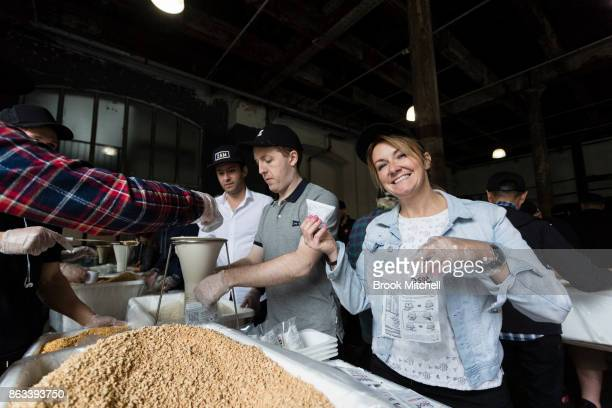 Volunteers lend a hand during Zambrero's meal packing day on October 20 2017 in Sydney Australia More than 1700 volunteers across Australia come...