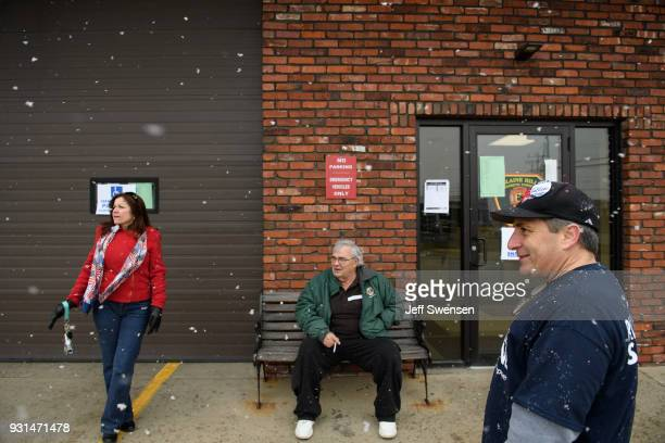 Volunteers Lesa DeMaio left and her husband Bernie right greet voters showing up to place their ballots in a special election between Democratic...