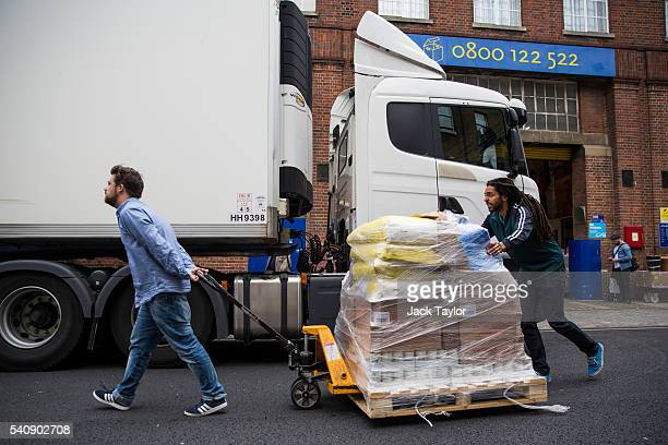 Volunteers load aid for refugees and migrants living in Calais onto a truck outside Access Self Storage on June 17 2016 in London England Despite...