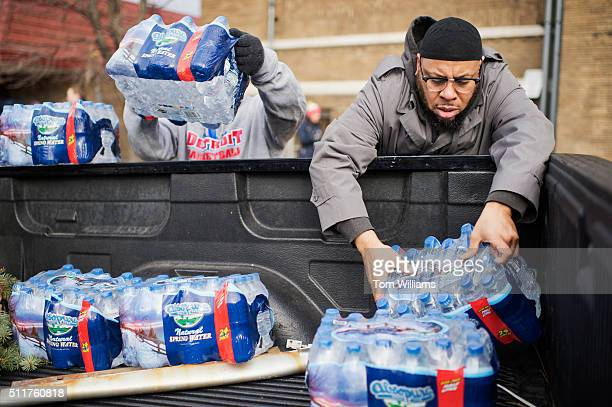 Volunteers load bottled water in a truck at the the Sylvester Broome Center in Flint Mich February 22 2016 The center is being used for water...