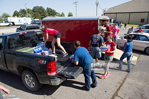 Volunteers load water at Beryl Baptist Church after a tornado yesterday tore through the area for the second time in three years on April 28 2014 in...