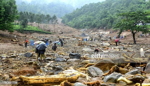 TOPSHOT Volunteers local residents and members of National Disaster Response Force search for survivors in the debris left by a landslide at...