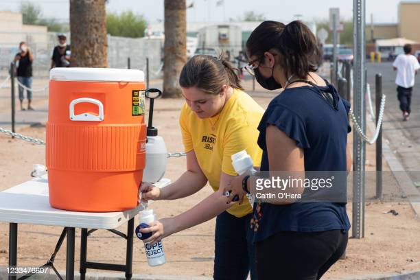 Volunteers Mackenzie Zollner and Lina Ali pass out out water to the homeless on June 15, 2021 in Phoenix, Arizona. The National Weather Service has...