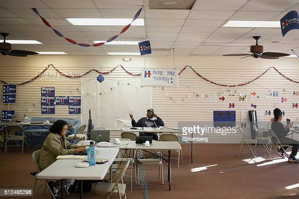 Volunteers make phone calls to voters at a Hillary Clinton former Secretary of State and 2016 Democratic presidential candidate campaign field office...