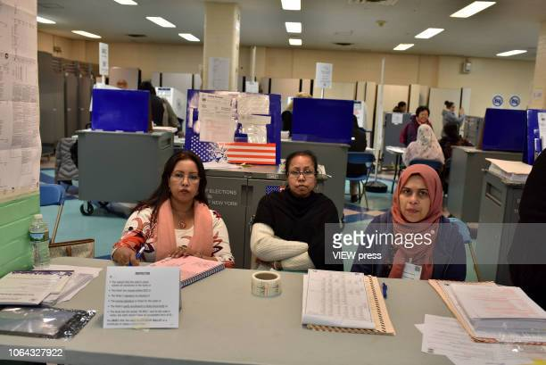 Volunteers man the polls for the midterm election at PS 69 on November 6 2018 in the Jackson Heights neighborhood of the Queens borough of New York...