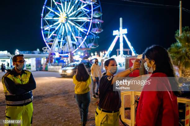 Volunteers measure the temperature at the entrance to the Luna Park in Molfetta at Secca dei Pali on 3 October 2020 First day of opening of the Luna...