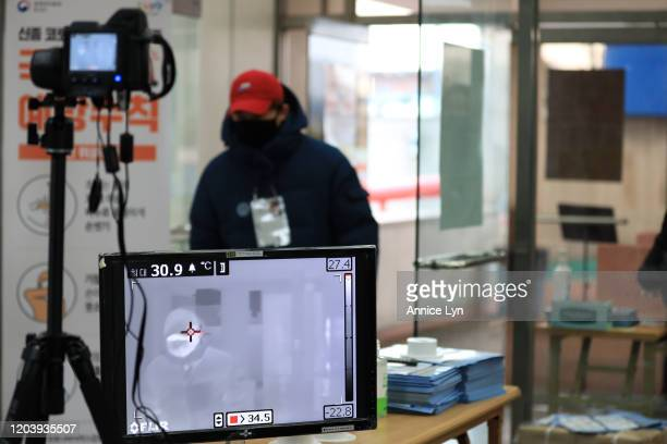 Volunteers monitor thermography at the quarantine inspection station as audience attend the ISU Four Continents Figure Skating Championships at...