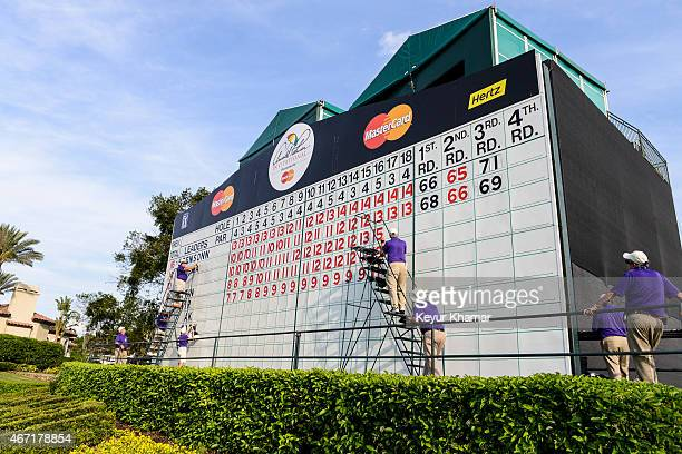Volunteers move Henrik Stenson's score above Morgan Hoffmann's on the scoreboard following the third round of the Arnold Palmer Invitational...