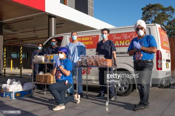 Volunteers of Guru Nanak Free Kitchenette Sydney seen distributing free food at Blacktown Hospital on Saturday 25th April in Sydney Australia GNFKS...