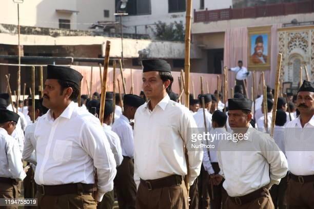Volunteers of Hindu nationalist Rashtriya Swayamsevak Sangh , taking out a march past in Ajmer, India, on 19 January 2020.