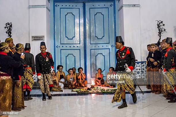 Volunteers of Kasunanan Surakarta known as 'Abdi Dalem' pray during the traditional night carnival '1st Suro' marking the 1437th Islamic New Year...