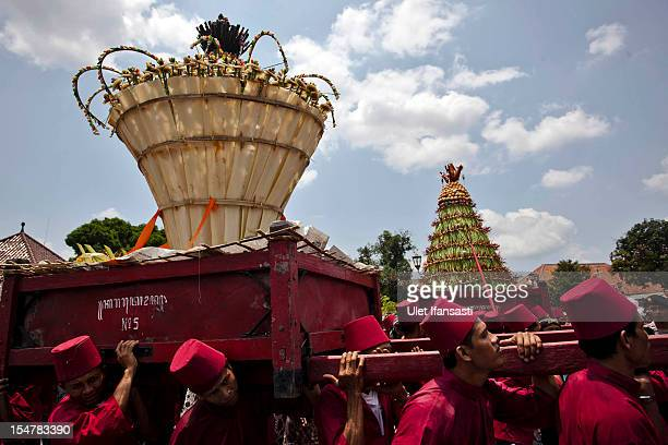 Volunteers of Kraton Palace, known as 'Abdi Dalem', carry 'Gunungan' from Kraton Palace to the Great Mosque Kauman during the Grebeg ritual as part...