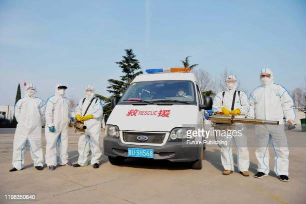 Volunteers of Red Cross automobile Public Welfare Alliance disinfect a foreign enterprise and create a good health environment for the enterprise to...