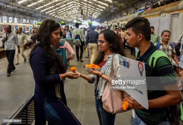 Volunteers of Rotary making people aware of cleanliness by presenting flowers during #SwachchtaHiSeva campaign at Churchgate station on September 18...