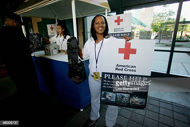 Volunteers of the American Red Cross accept donations from fans before the start of Game Three of the 2005 Major League Baseball World Series between...