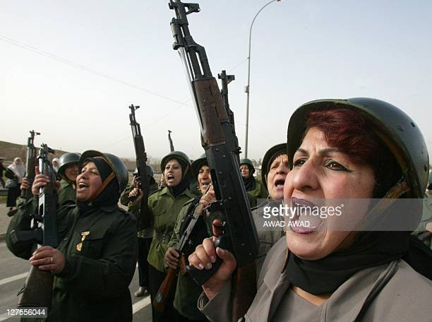 Volunteers of the army of AlQuds shout antiUS slogans during a military parade in the northern Iraqi city of Mosul 04 February 2003 An estimated...