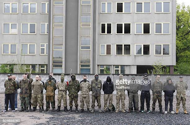 Volunteers of the Azov Battalion stand in line during a ceremony before being sent to eastern Ukraine in Kiev Ukraine 07 May 2015 Officials from...