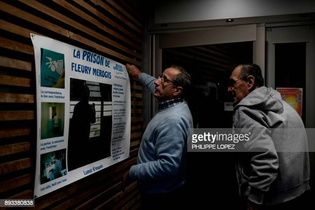 Volunteers of the Christian charity organization 'Secours Catholique' set up a poster in a building used to welcome volunteers prior to a Christmas...
