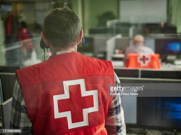 Volunteers of the Red Cross answer to phone calls to help during the coronavirus crisis on March 30, 2020 in Pamplona, Spain.