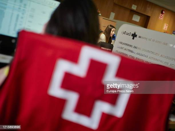 Volunteers of the Red Cross answer to phone calls to help during the coronavirus crisis on March 30 2020 in Pamplona Spain