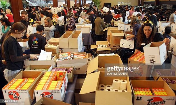 Volunteers of the UAEbased charity organisation Dubai Cares prepare boxes of supplies bound for the Gaza Strip as part of its 'Children of Gaza'...