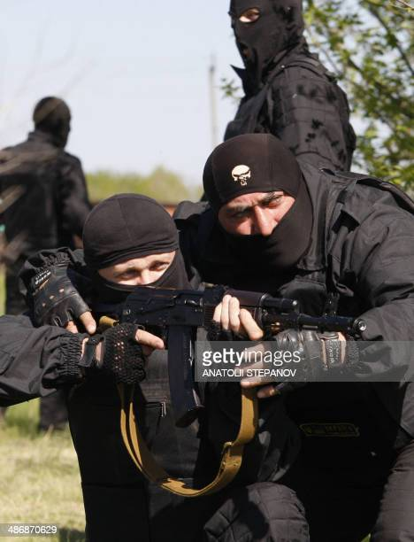 """Volunteers of the Ukrainian battalion """"Donbass"""" take part in exercises in their camp on the border between Dnipropetrovsk and Donetsk regions on..."""