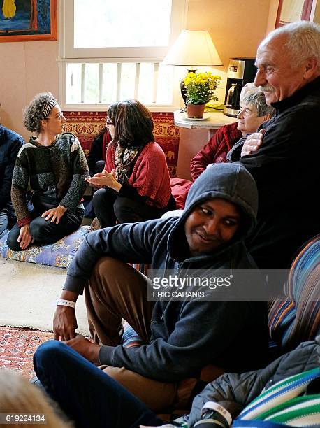 Volunteers of the village social worker and Sudanese refugees talk in the 'Centre dAccueil et dOrientation pour migrants' in Bruniquel near Montauban...