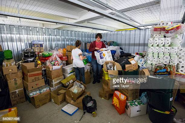Volunteers organise aid for refugees and migrants living in Calais at a storage facility in London on June 17 2016 in London England Despite French...
