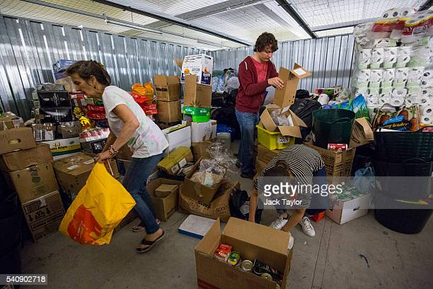 Volunteers organise aid for refugees and migrants living in Calais at a storage facility on June 17 2016 in London England Despite French border...