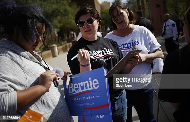 Volunteers organize outside a campaign event for Senator Bernie Sanders an independent from Vermont and 2016 Democratic presidential candidate not...