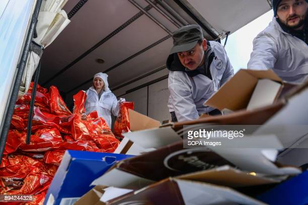 Volunteers organize the christmas gift bags during the 21st Edition of the Biggest Christmas table in Europe at the Main Square in Krakow The so...