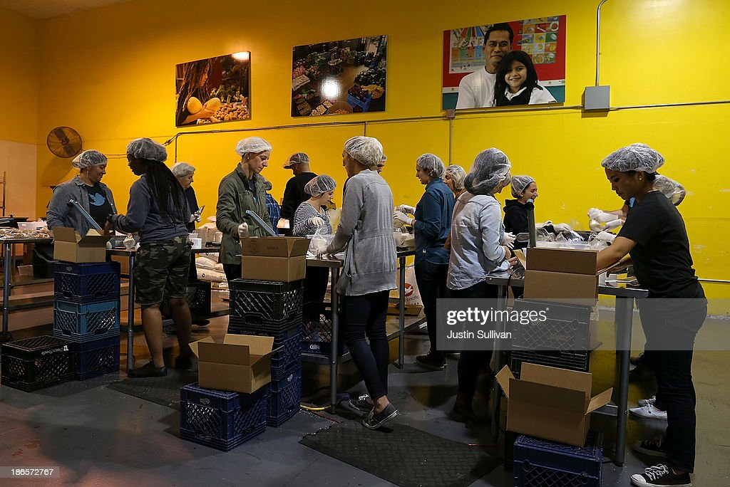 Volunteers Pack Bags Of Rice At The San Francisco Food Bank On