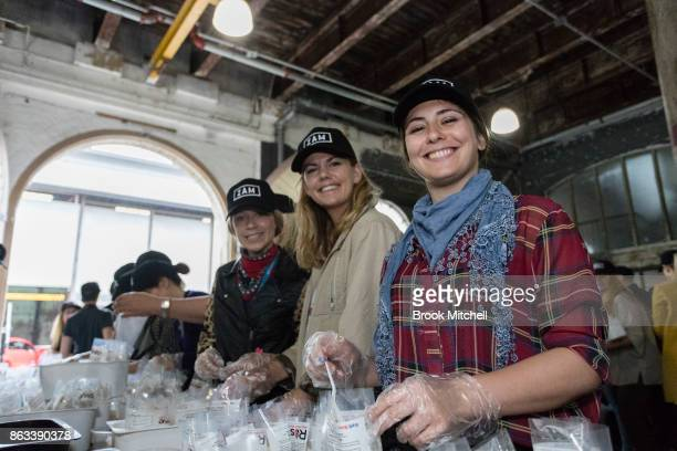 Volunteers pack meals during Zambrero's meal packing day on October 20 2017 in Sydney Australia More than 1700 volunteers across Australia come...