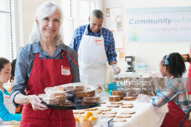 Volunteers packing food in community kitchen