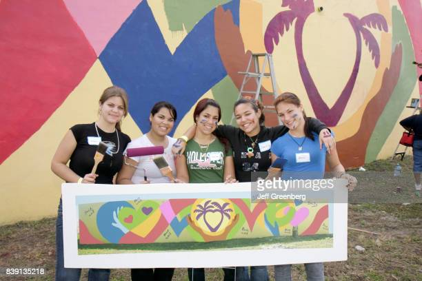 Volunteers painting a mural at Hands on Miami Day