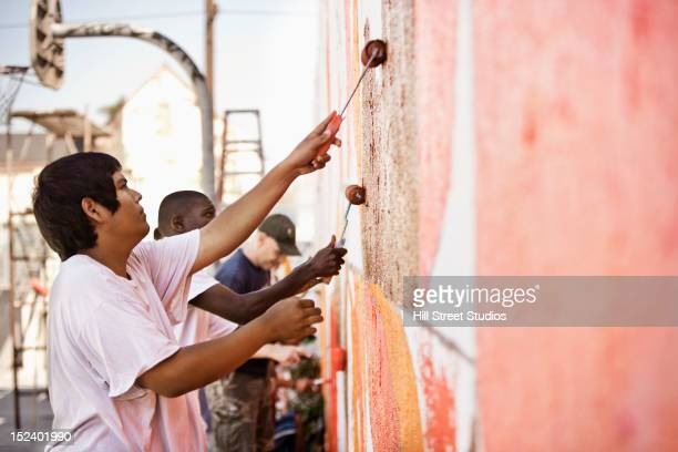 Volunteers painting wall