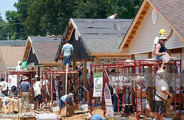 Volunteers participate in 'blitz builds' of Habitat for Humanity homes June 10 2003 in LaGrange Georgia More than 90 homes are being built in...