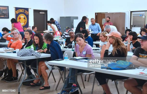 Volunteers participating in a morning canvassing of residential neighborhoods trying to register voters in Palmdale California attend a morning...