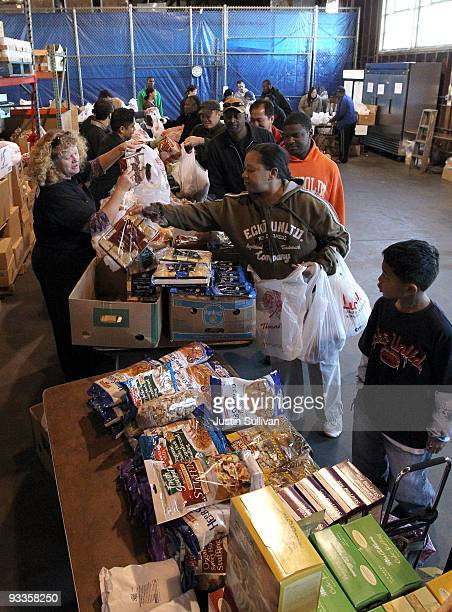 Volunteers pass out fresh vegetables and bread for a Thanksgiving meal November 24 2009 at the Alameda Food Bank in Alameda California Hundreds of...