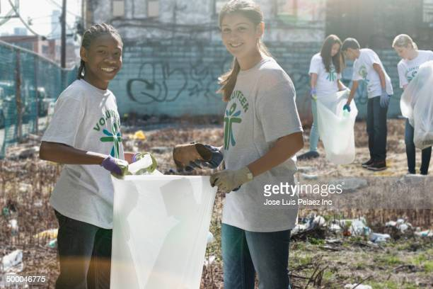 Volunteers picking up litter in urban lot