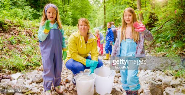 portrait smiling girls woman collecting plastic