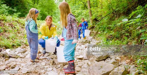 girls woman collecting plastic rubbish bucket
