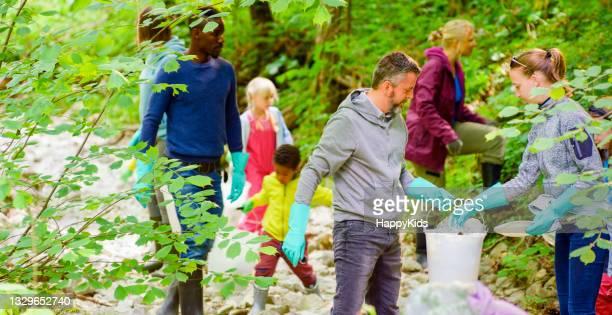 male female volunteers picking up plastic