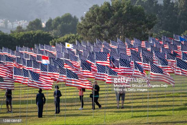Volunteers place flags on the lawn in front of PepperdineUniversity for their annual Wave of Flags display in Malibu, CA., Wednesday, September 8,...