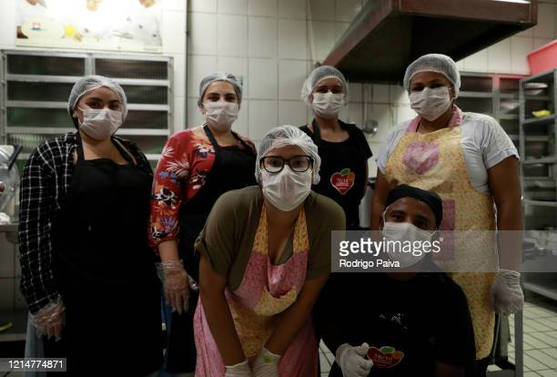 Volunteers pose for a photo before cooking to donate food to Paraisópolis residents on March 24 2020 in Sao Paulo Brazil Paraisopolis is the second...