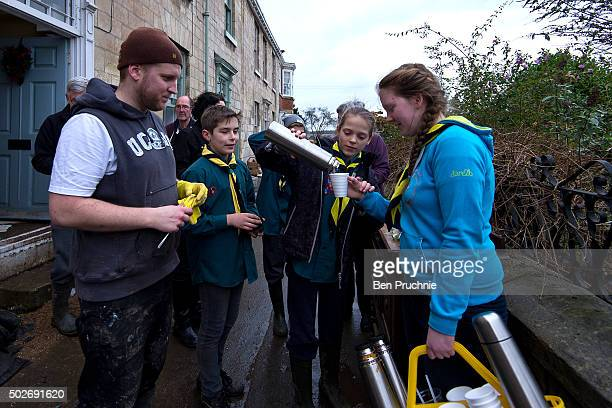 Volunteers pour tea for residents along the bank of the River Wharfe on Tadcaster High Street on December 28 2015 in TadcasterEngland Heavy rain over...